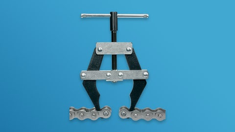 Chain puller for roller chains